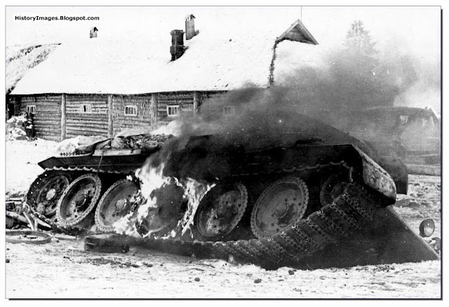 Soviet T-34 tank burns  outskirts of Moscow December 1941