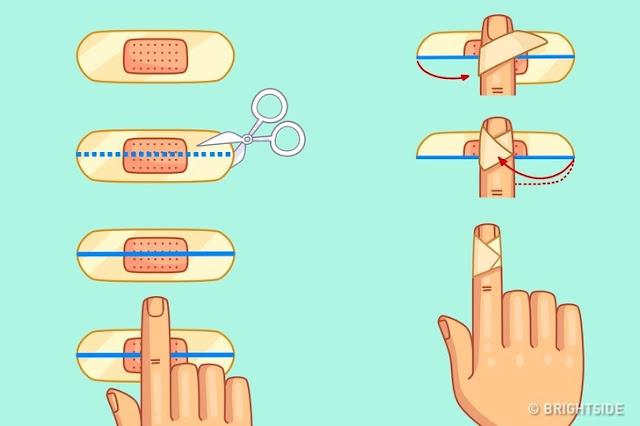 Aplicando um band-aid para um corte no seu dedo