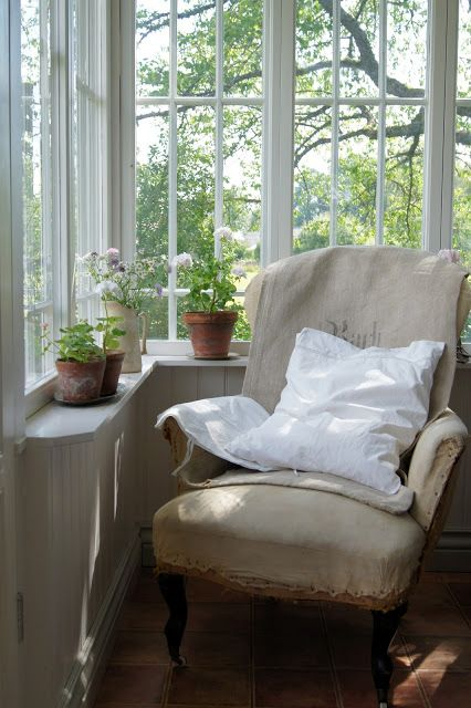 Swedish vintage chair at windows with greenery outdoors - found on Hello Lovely Studio