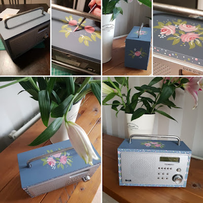 An old radio that has been hand painted with Roses using You Can Folk It's Vintage roses kit.  Photographed with painting in progress and the finished radio in the owners home
