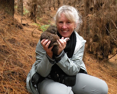 Cuddling kiwis in New Zealand.Photograph of Janie Robinson, Travel Writer