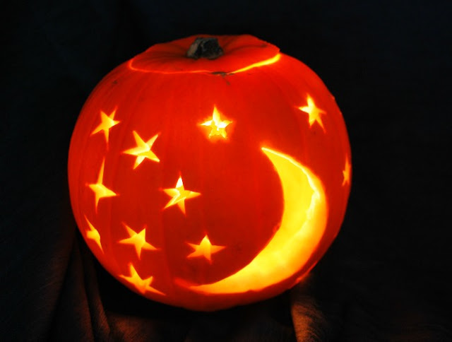 Pumpkin with Stars and Moon lit up lit up
