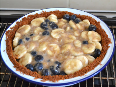 crumb crust pie filled with bananas and blueberries baked and enjoyed either warm or chilled with cream