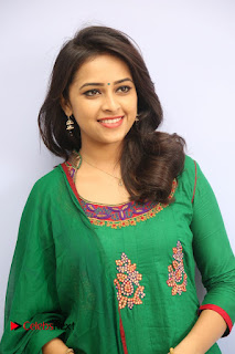 Actress Sri Divya Pictures in Green Salwar Kameez at Rayudu Team Meet  0007.JPG