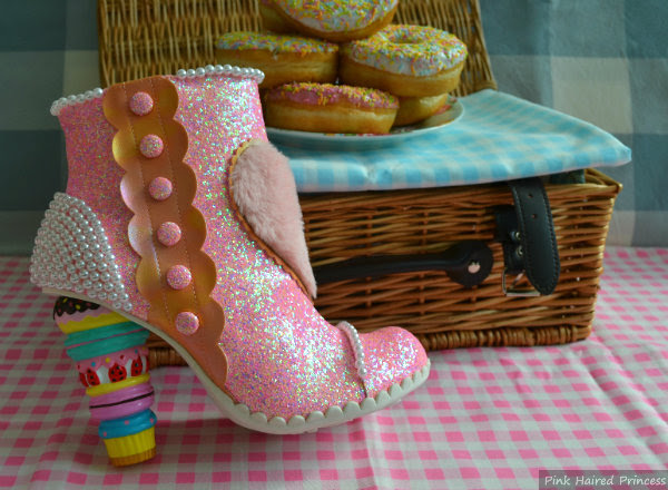 irregular choice bee delicious pink glitter macaron boot next to picnic basket