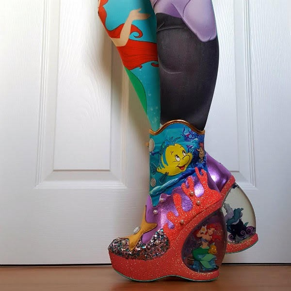 little mermaid water globe heeled boots on feet with patterned tights side view