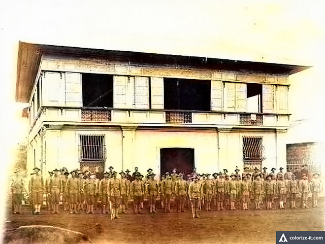 American troops during inspection in Batangas Town.  Image source:  Sandra Plummer Collection of the Fort Worth Library Digital Collection.  Colorized courtesy of Algorithmia.