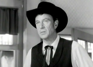 Gary Cooper wearing black hat in screen High Noon