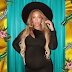 Beyonce puts her baby bump on display in new photos