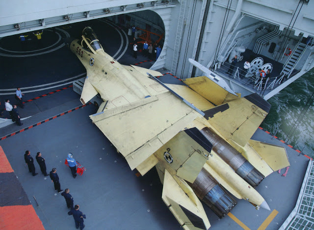 Two elevators lift the aircraft between the flight deck and the aircraft hangar