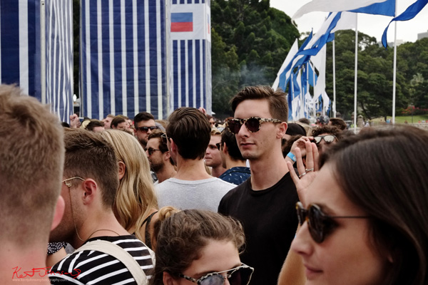 One man, head and shoulders above the crowd. Harbour Life Music Festival Sydney 2016. Photographed by Kent Johnson for Street Fashion Sydney.