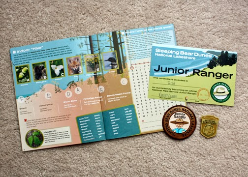 Tessa completed ten activities from the Junior Ranger booklet (only eight are required for her age), attended a ranger-led activity and completed a service project (she chose to pick up five pieces of trash) to complete Step 5 of her Hiker Badge and earn her Junior Ranger certificate. Sleeping Bear has an exceptionally good Junior Ranger program. I highly recommend it. In addition to the plastic Junior Ranger badge, Tessa also received a special patch that we may sew onto the back of her Brownie vest as a fun patch. Not all Junior Ranger programs offer a patch. She also received a Sleeping Bear pencil and was offered a poster.
