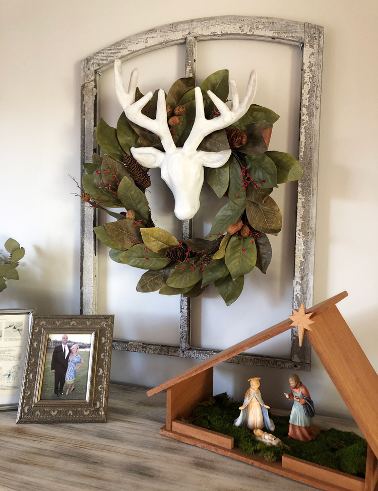 vintage window with magnolia wreath and deer head