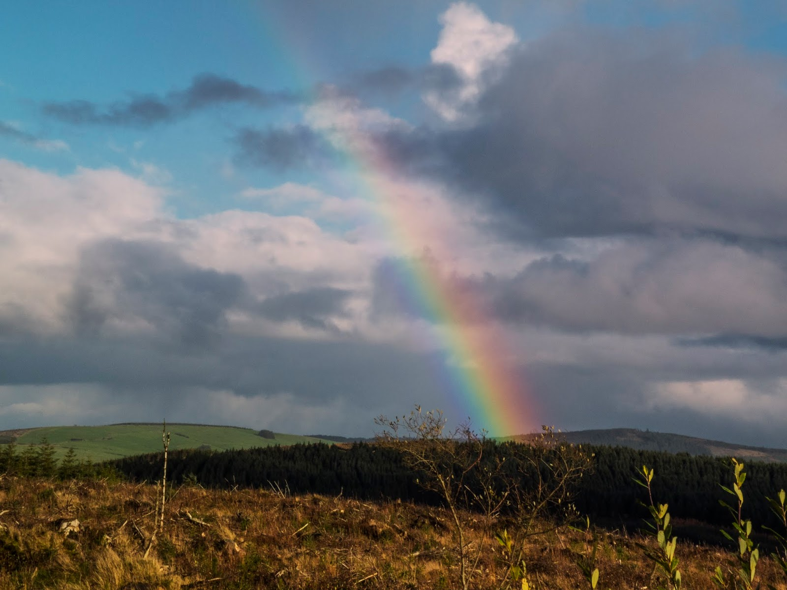 A rainbow streak in the cloudy sky over the Boggeragh Mountains in County Cork.