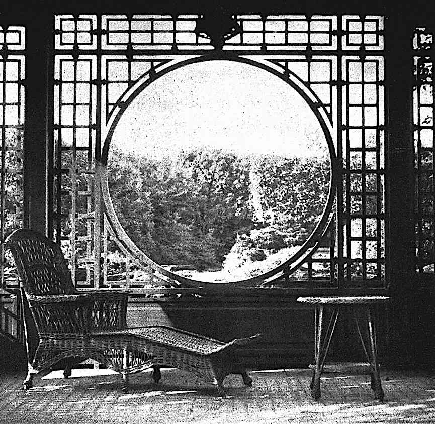 a photograph of a 1922 sun room circular window with wicker chaise longe