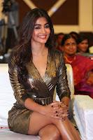 Pooja Hegde looks glamarous in deep neck sleevless short tight golden gown at Duvvada Jagannadham thank you meet function 138.JPG