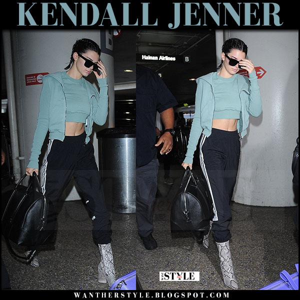 Kendall Jenner in teal crop top, teal hoodie rick owens and snakeskin boots yeezy season 4 what she wore june 30 2017 airport style
