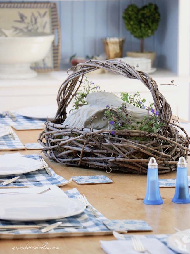 Choose flowers for a French country floral centerpiece bunny basket that complement your home's colors
