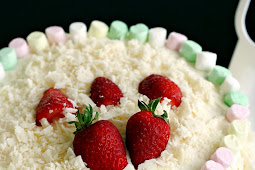 Strawberries and Cream Sponge Cake with White Chocolate Flakes