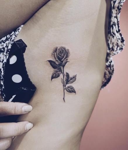 Este blackwork rose tattoo