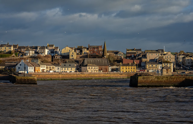 Photo of Maryport from across the basin at high tide