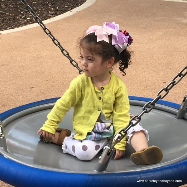 child on swing at Hemisfair in San Antonio, Texas