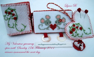 Cross stitched Needlecase and loveheart ornament with polymer clay roses
