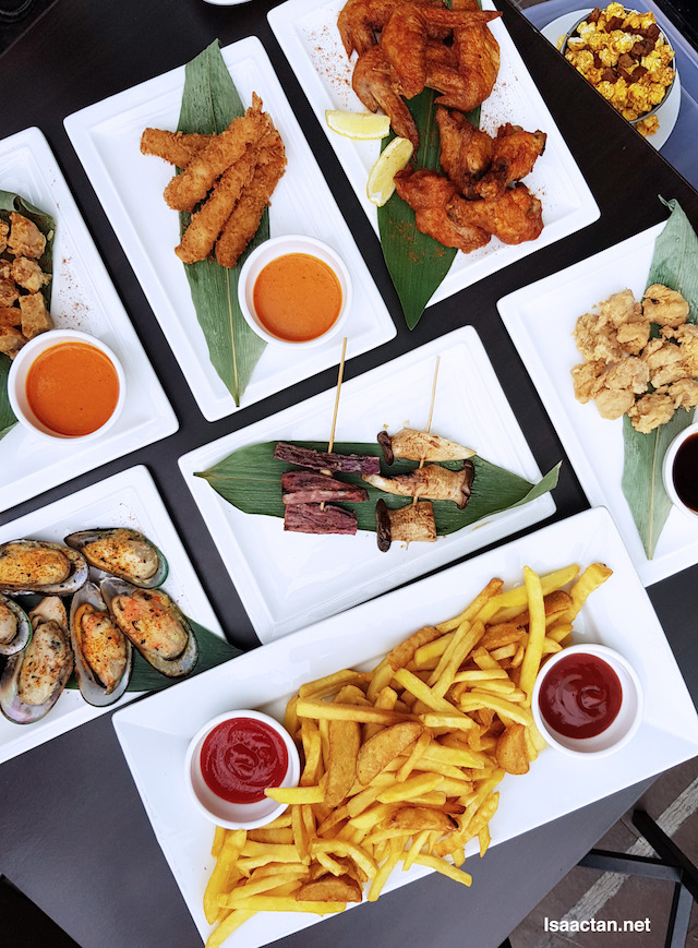 Tap It Out Snacks and Finger Food such as Yakitori, Popcorn Chicken, Roast Pork Belly, Trufle Fries, Prawn Katsu, Flaming Wings and more!