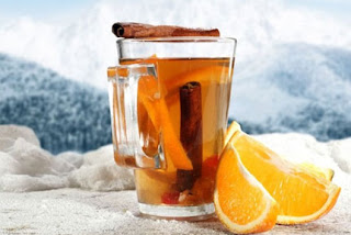 German white Gluhwein in a cup in a snowy area