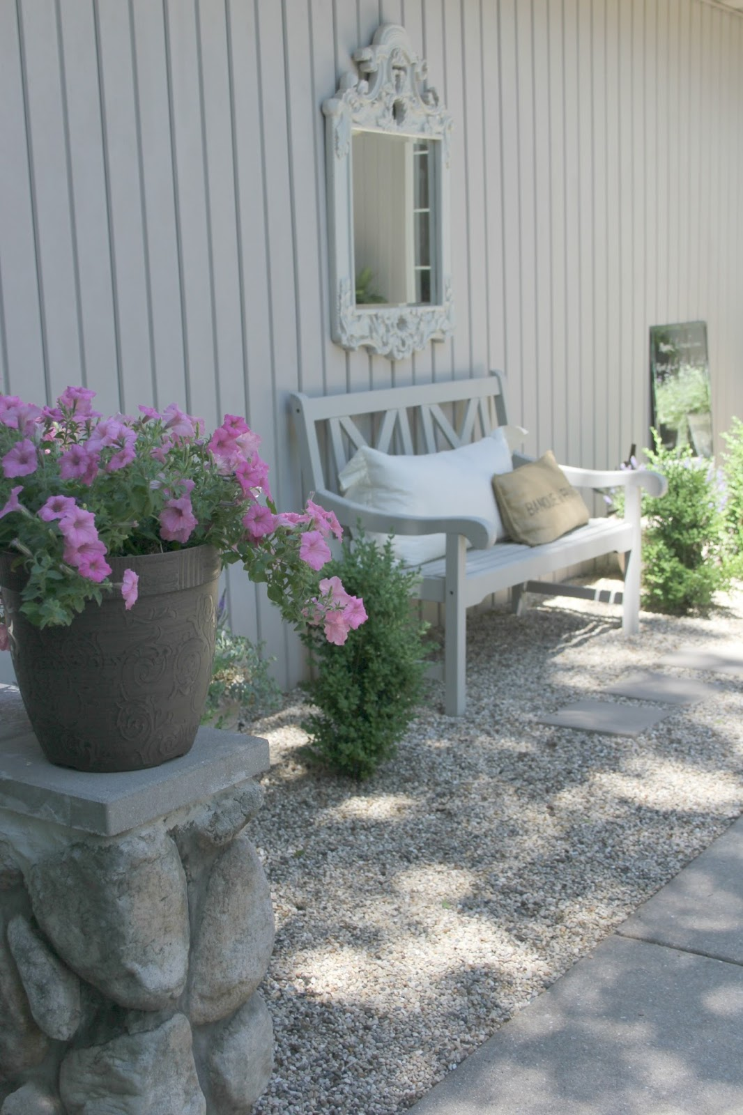 Peaceful living in a French country courtyard with pea gravel. Come be inspired on Hello Lovely by 7 Low Cost Timeless Decorating Ideas That Don't Involve the Dollar Store As Well As Photos Around My House.
