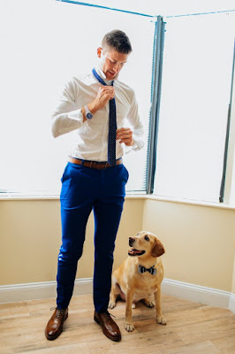groom getting ready with pet before wedding