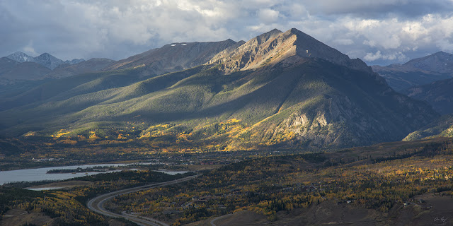Sun dancing on Peak 1 from Silverthorne, Colorado lake dillon in the Fall