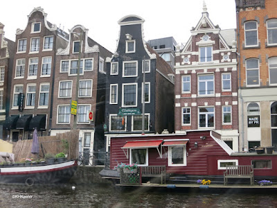 houses on the canal in Amsterdam