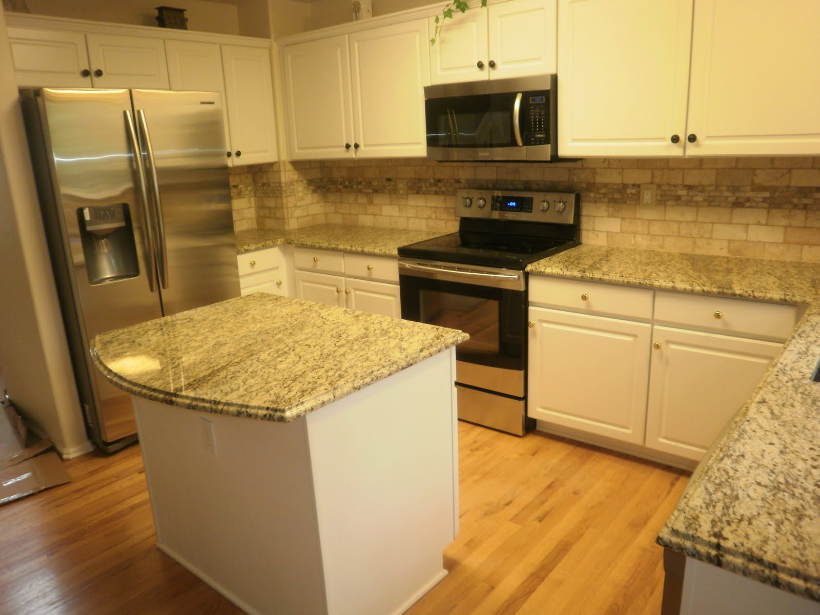 Santa Cecilia Granite with White Kitchen Cabinets