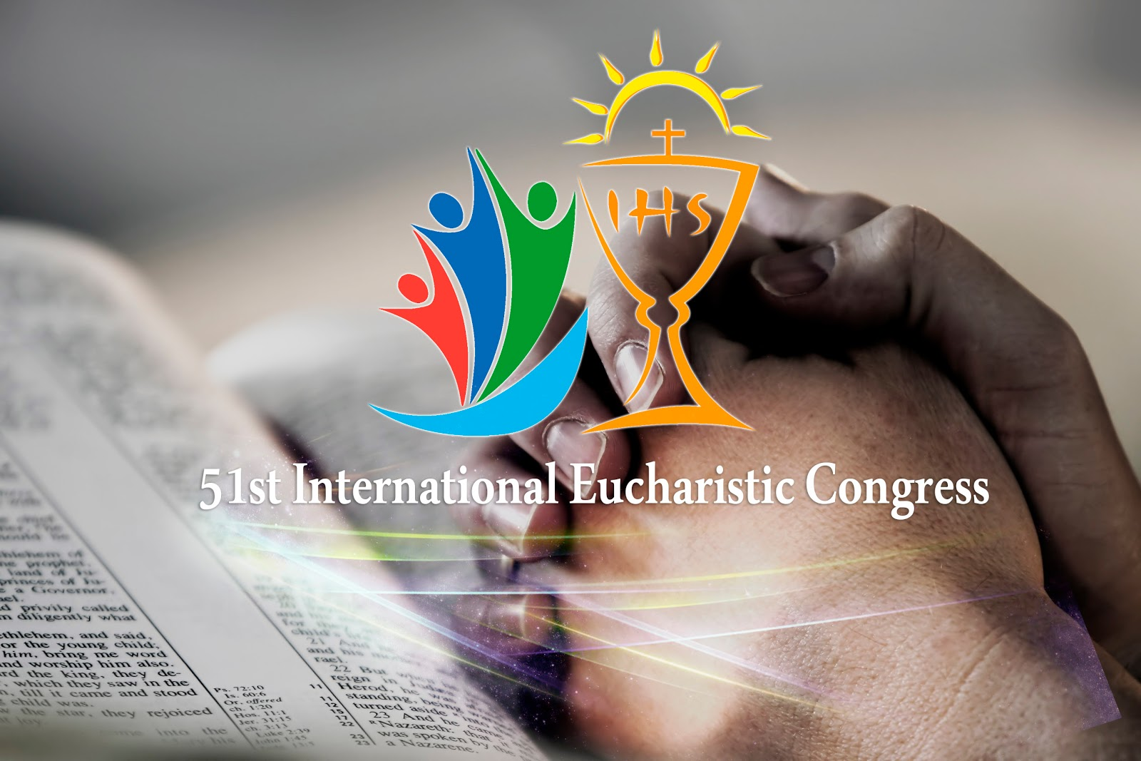 Praying hands with IEC logo
