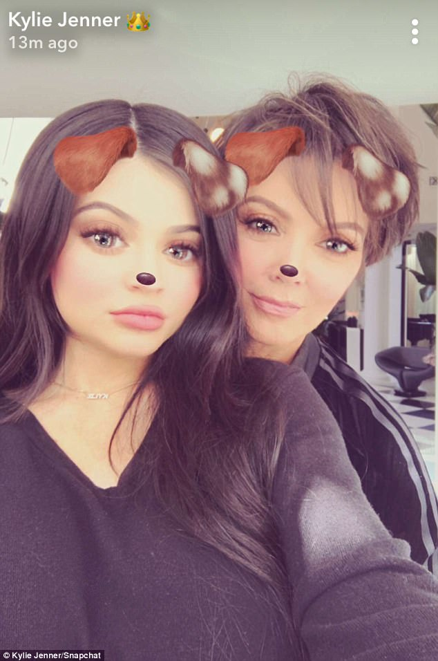 Hiding something? Kylie Jenner crops out stomach as she goes on snapchat with mom Kris Jenner