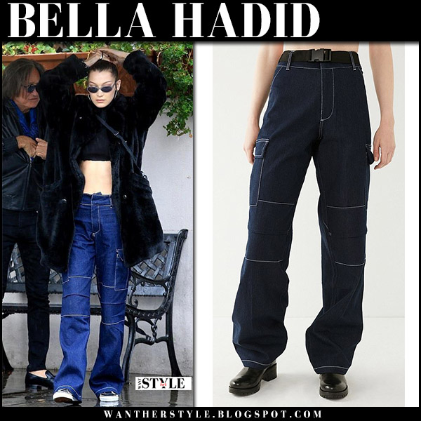 Bella Hadid in black coat, crop top, vans sneakers and denim cargo pants i.am.gia ace model street style january 9
