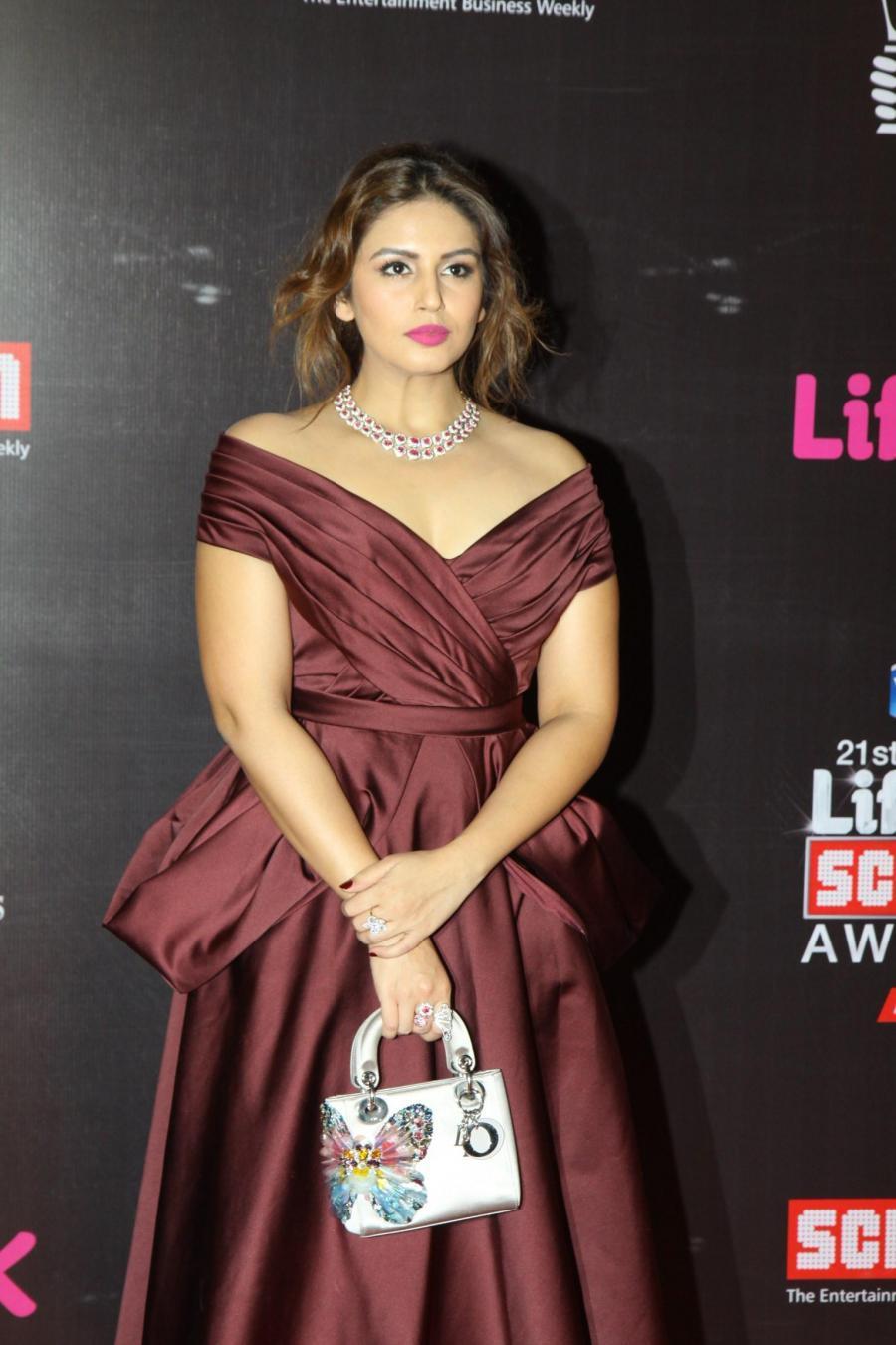 Huma Qureshi Stills In Maroon Dress At Screen Awards