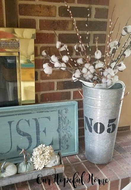 vintage chicken feeder plush pumpkins dried hydrangeas galvanized flower bucket cotton stems farmhouse sign