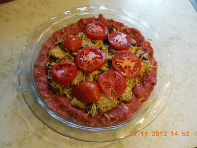 Hamburger Pie, made with a hamburger crust, filled with mushrooms, cheese and tomatoes.