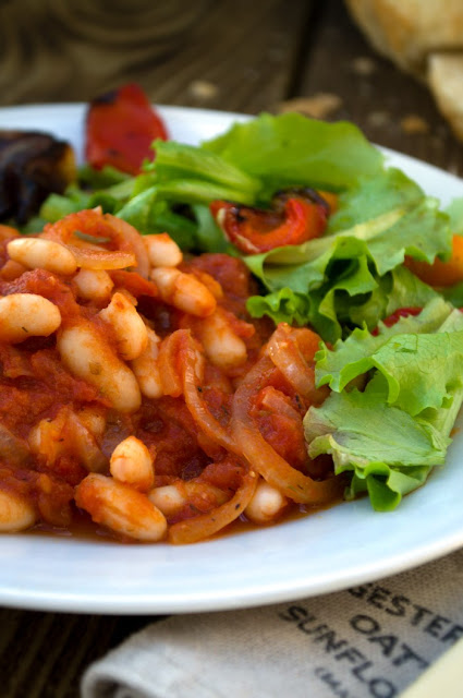 Rustic Greek Beans (Fasolia Gigantes).A rich bean stew high in protein, fibre and iron. Easy to make and very tasty. Serve with crusty bread and salad or steamed vegetables, Suitable for vegetarians and vegans.