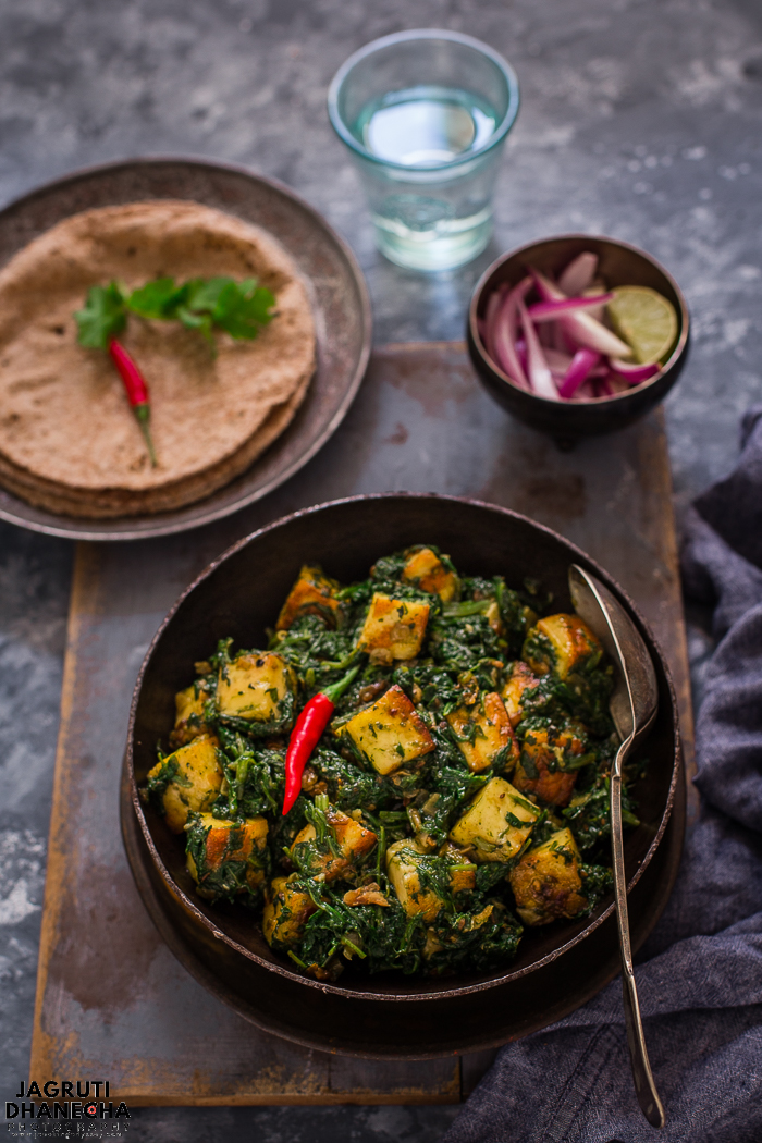 Saag paneer is a North Indian style of preparing spinach and Indian cottage cheese, Saag aka spinach and Panner is freshly made Indian cottage cheese. This classic version is an easy and simple recipe, can be ready in less than 30 minutes, freshly cut spinach and paneer is cooked with basic spices and onion, garlic. This saag paneer with plenty of flavours, gluten-free and perfect for a vegetarian dining.