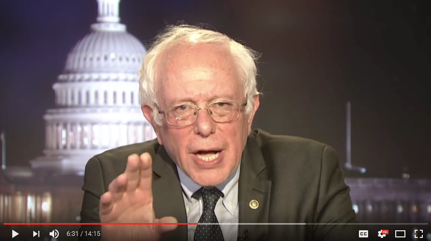 Bernie discusses a speech he'd heard. A speech with a pair of potted plants behind the speaker.