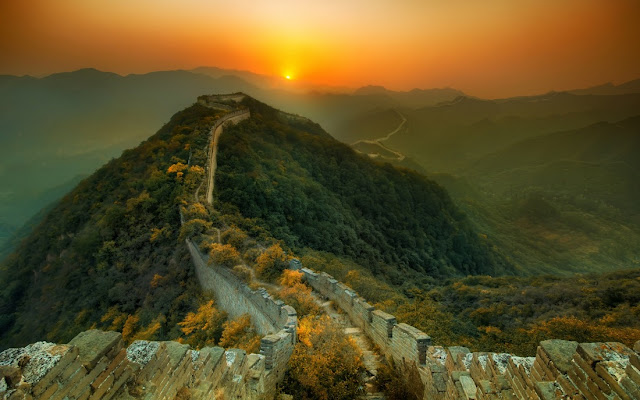 Great Wall of China with Sun on Horizon