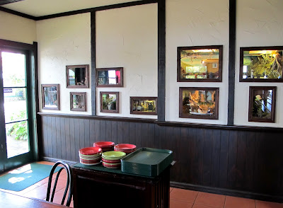 View of the one-twelfth-scale miniature scenes set into the wall of Mr Badger's cafe at Tawhiti Museum..