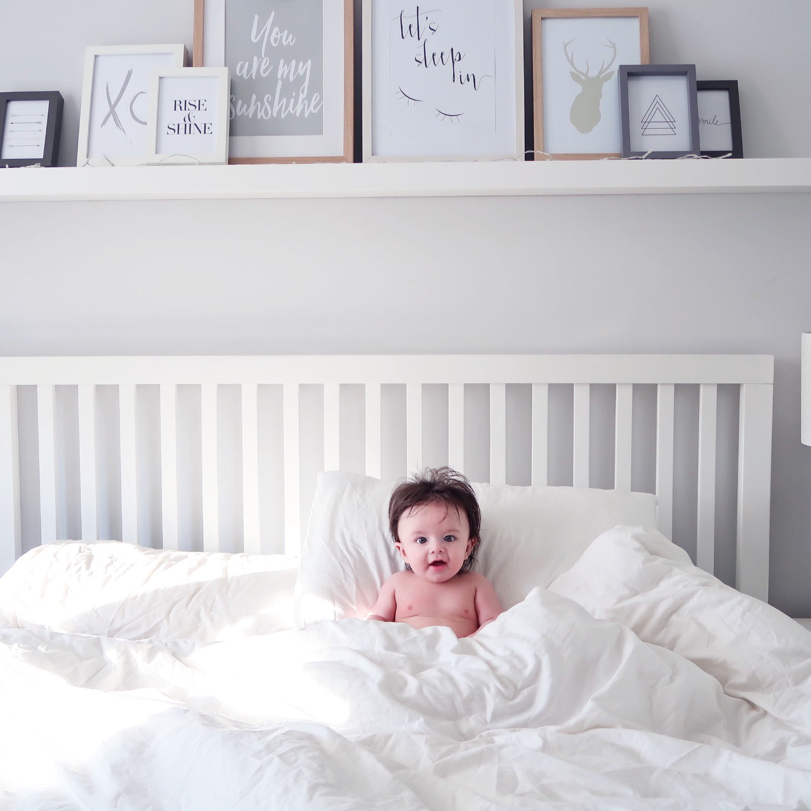 Maisy Meow Lifestyle and Parenting Blogger Baby on bed photoshoot