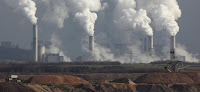 Coal power plant smokestacks with tailings (Photo Credit: alohaspirit/iStock) Click to Enlarge.