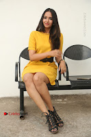 Actress Poojitha Stills in Yellow Short Dress at Darshakudu Movie Teaser Launch .COM 0193.JPG