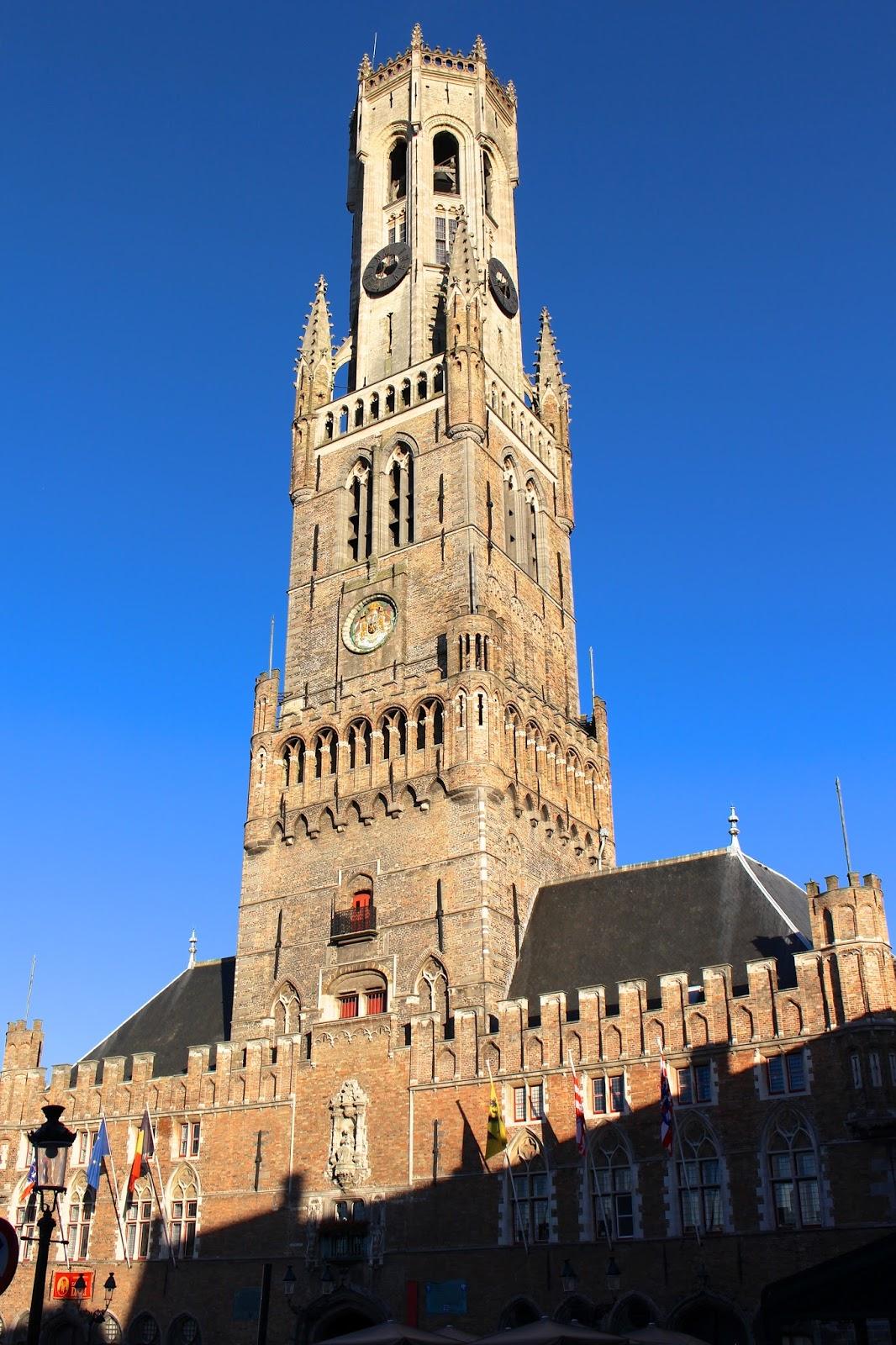 Belfry of Bruges at summertime sunset