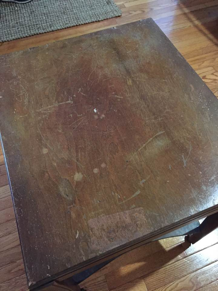 Before: Damaged surface on top of table